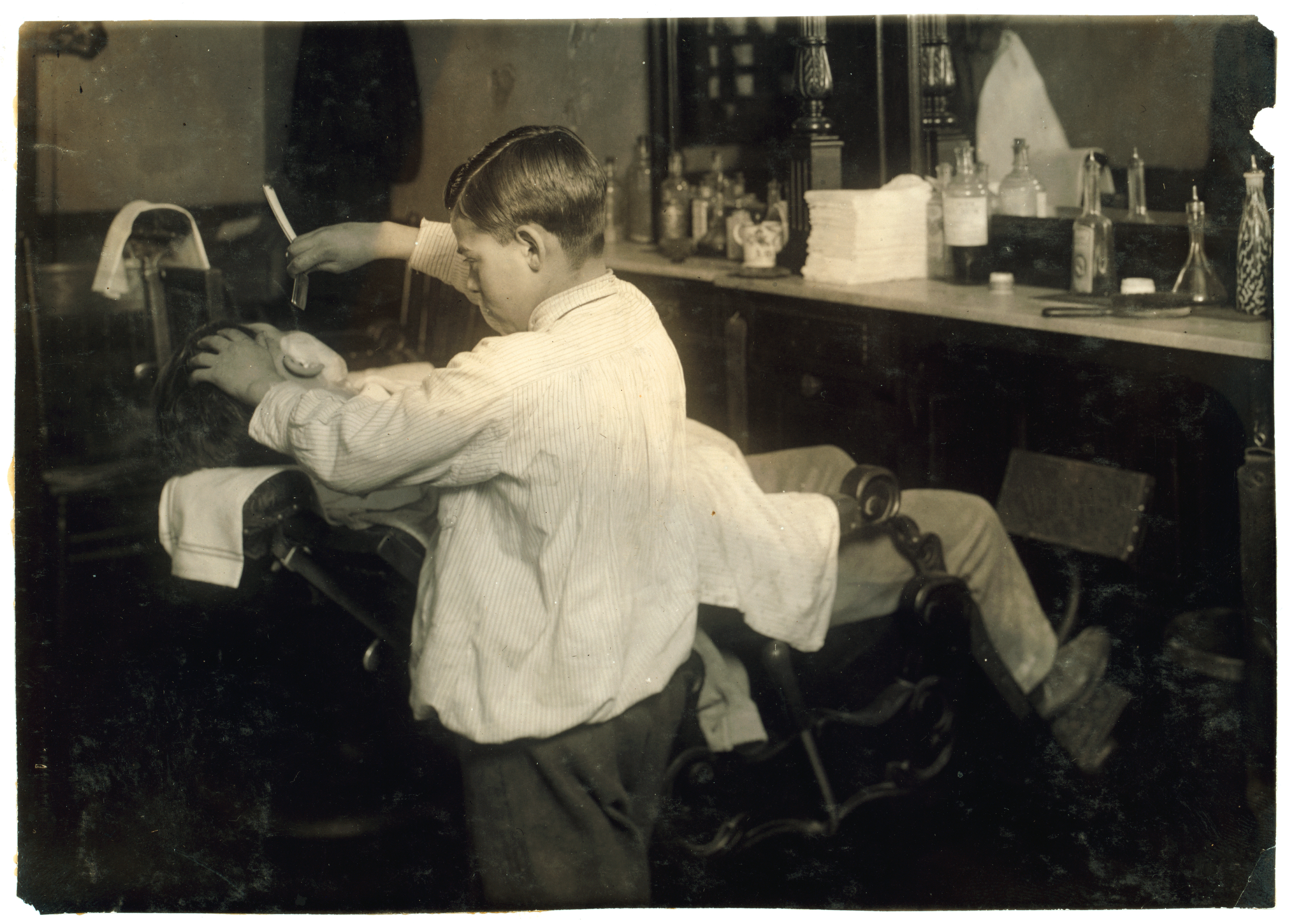 Barber And Shave Shoppe : Afflictor.com ? Barber, Twelve Years Old, Shaves A Head (1917)