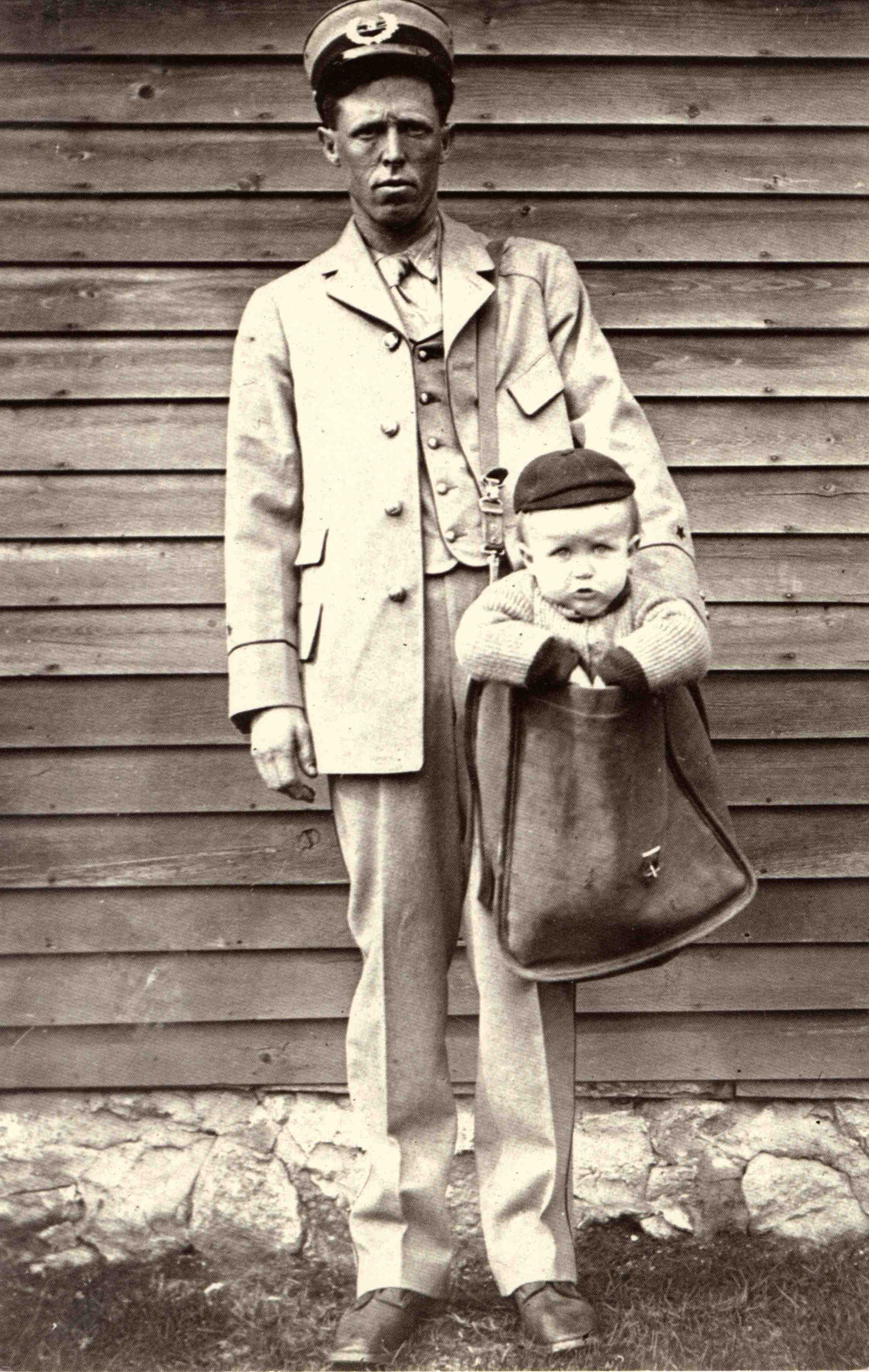 Uniformed_Letter_Carrier_with_Child_in_Mailbag1-2