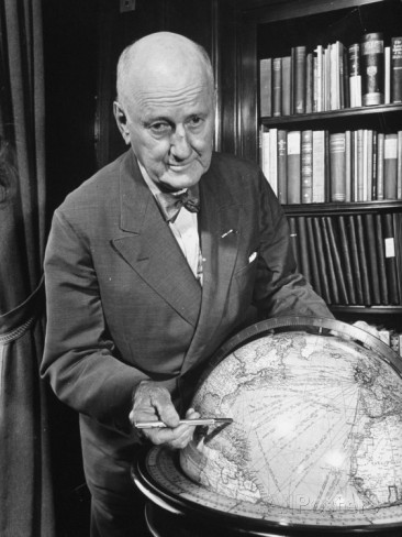 bernard-hoffman-major-general-james-g-harbord-pointing-to-the-west-indies-on-a-globe-in-his-study