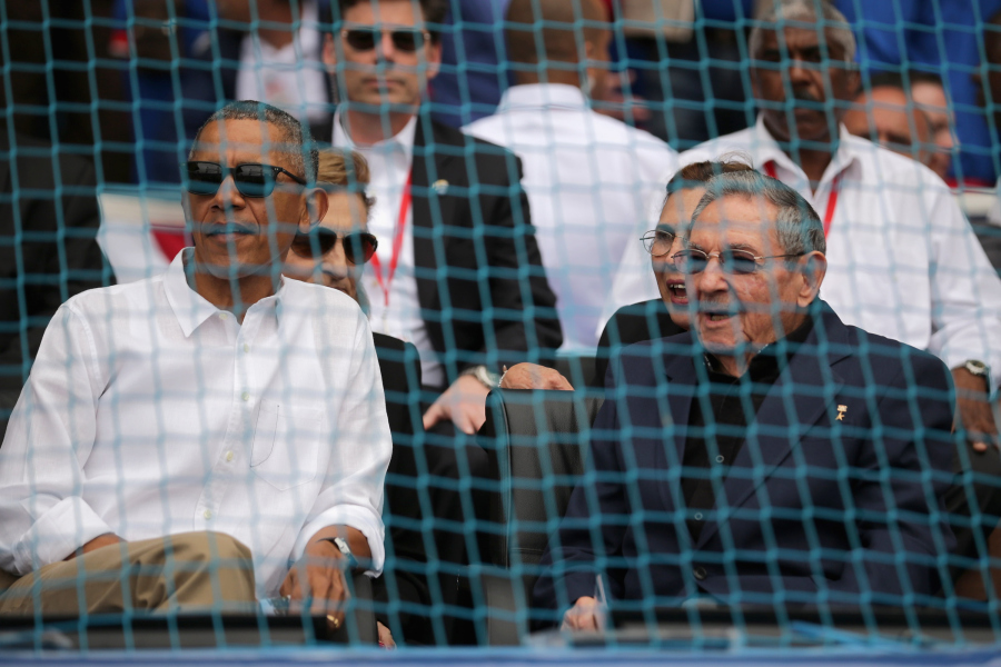 HAVANA, CUBA - MARCH 22: U.S. President Barack Obama (L) and Cuban President Raul Castro talk before the start of an exposition game between the Cuban national team and the Major League Baseball team Tampa Bay Devil Rays at the Estado Latinoamericano March 22, 2016 in Havana, Cuba. This is the first time a sittng president has visited Cuba in 88 years. (Photo by Chip Somodevilla/Getty Images)