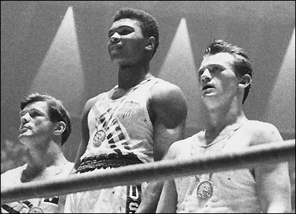 The winners of the 1960 Olympic medals for light heavyweight boxing on the winners' podium at Rome: Cassius Clay (now Muhammad Ali) (C), gold; Zbigniew Pietrzykowski of Poland (R), silver; and Giulio Saraudi (Italy) and Anthony Madigan (Australia), joint bronze. (Photo by Central Press/Getty Images)