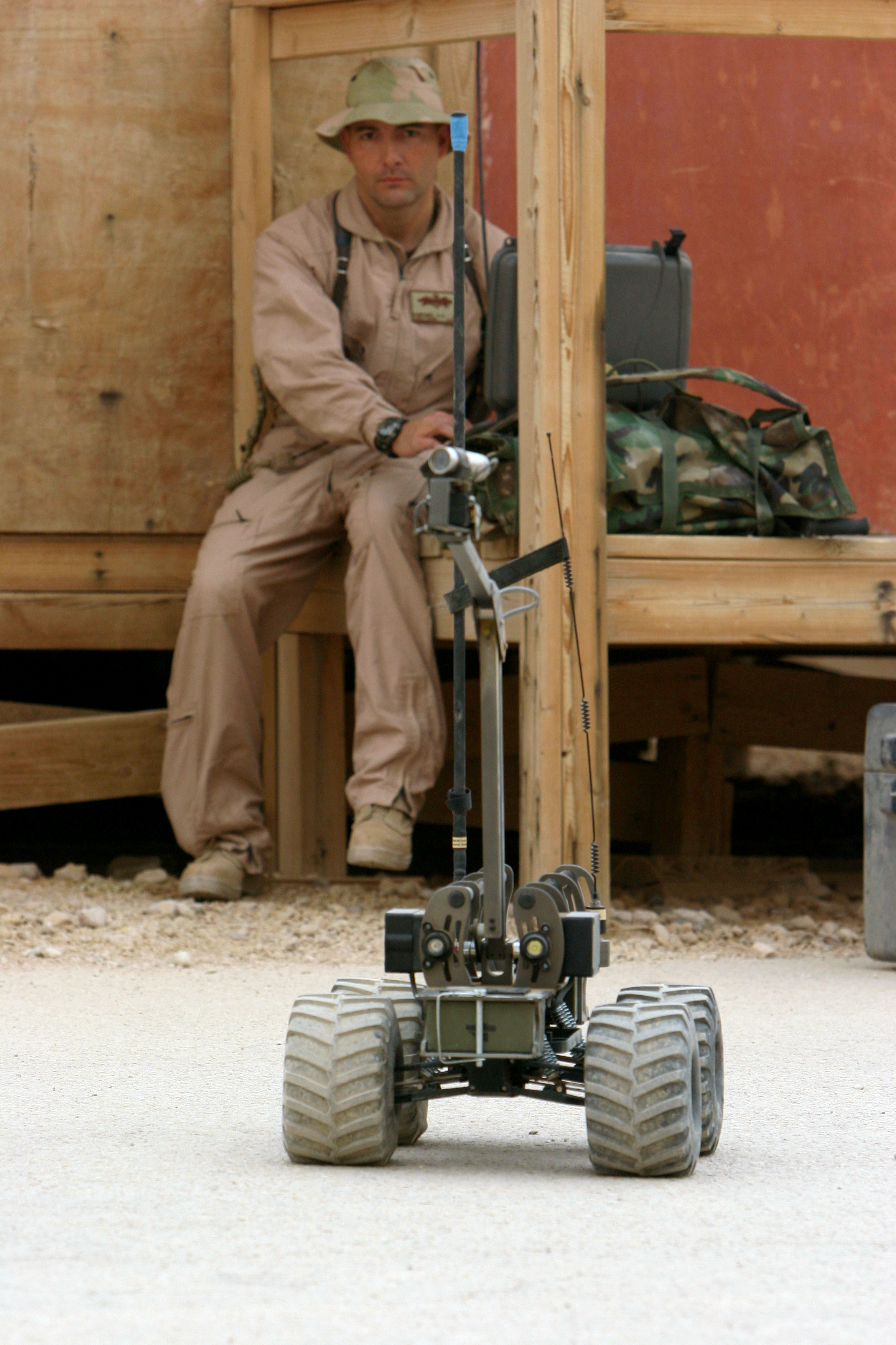 "080326-N-9623R-007 Iraq (March 26, 2008) Construction Electrician 2nd Class Greg Martinez, assigned to the convoy security element (CSE ) of Naval Mobile Construction Battalion (NMCB) 17, controls the MARCBOT IV, a remote controlled vehicle mounted with a video camera which is used to investigate suspicious areas without putting team members at risk. NMCB -17 CSE teams are highly trained Seabees tasked with the safe movement of various convoys to and from their missions. NMCB-17, also known as the ""Desert Battalion"", is to Iraq and other areas of operations supporting Operation Iraqi Freedom and Enduring Freedom. U.S. Navy photo by Mass Communication Specialist 2nd Class Kenneth W. Robinson (Released)"