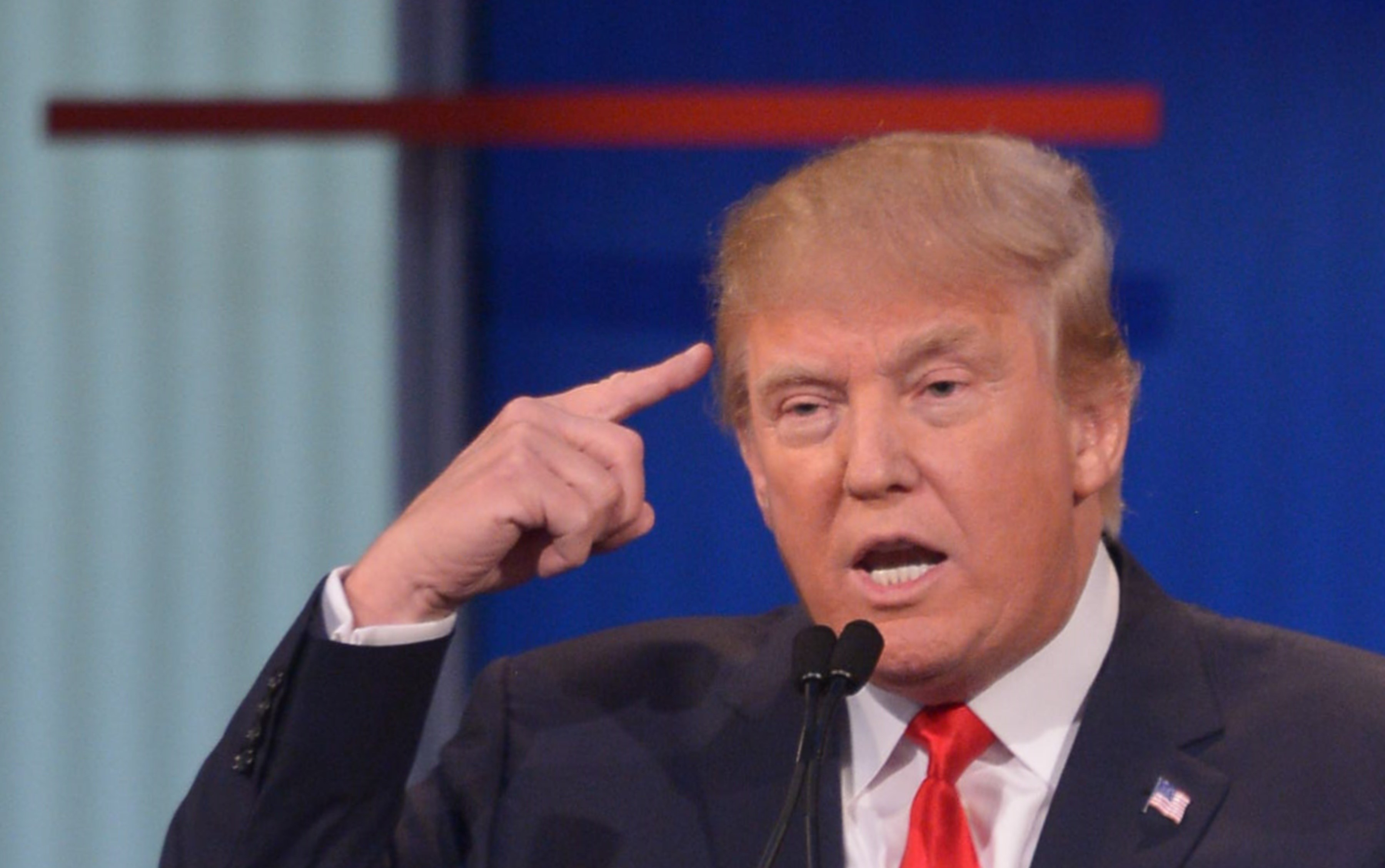 Real estate tycoon Donald Trump participates in the Republican presidential primary debate on August 6, 2015 at the Quicken Loans Arena in Cleveland, Ohio. AFP PHOTO / MANDEL NGAN        (Photo credit should read MANDEL NGAN/AFP/Getty Images)