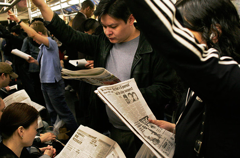 nyc_subway_riders_with_their_newspapers-travis-ruse