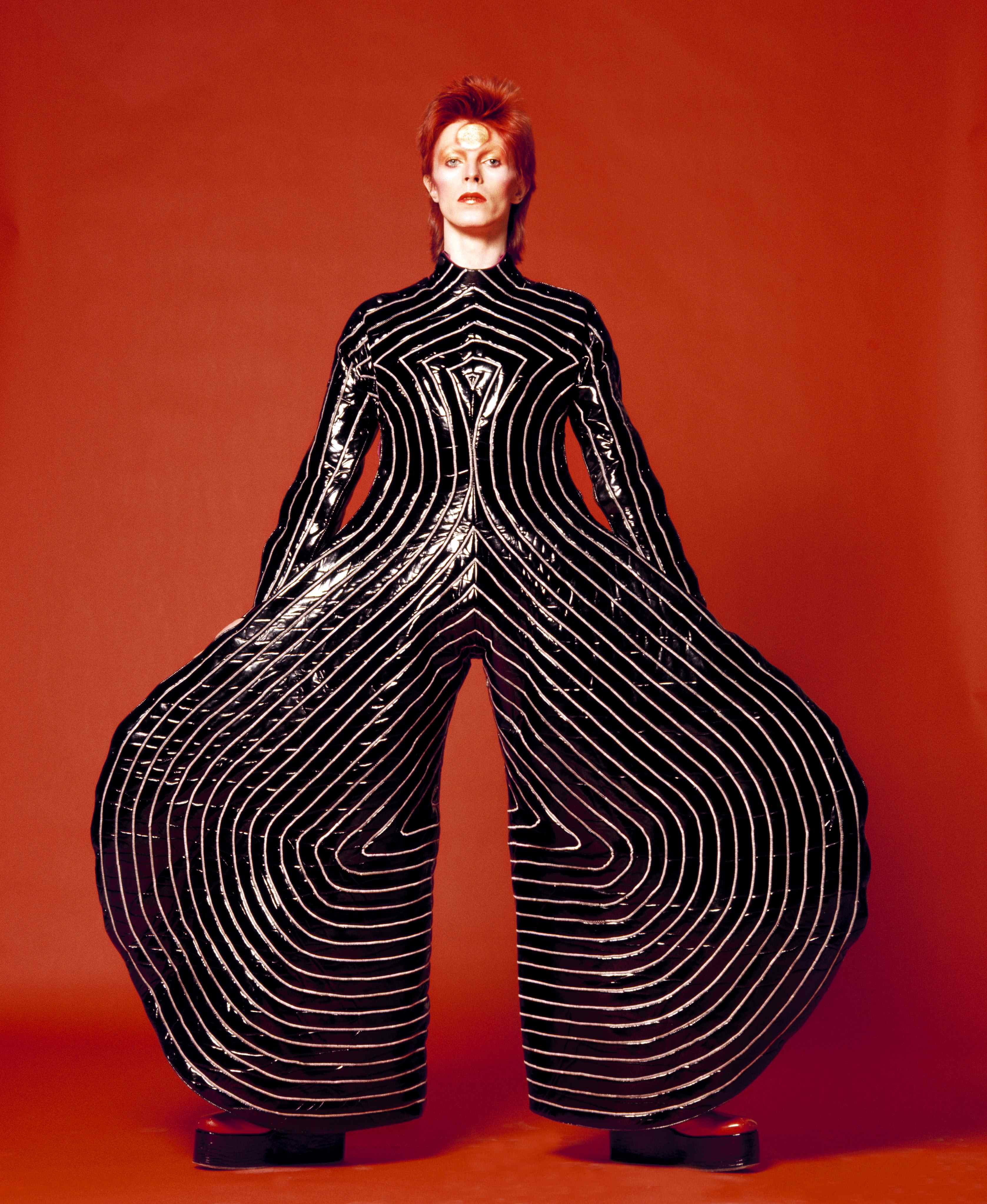 """Striped bodysuit for Aladdin Sane tour 1973 Design by Kansai Yamamoto Photograph by Masayoshi Sukita  Sukita The David Bowie Arc """"Bowie Himself Is Unlikely To Last Long As A Cult"""""""